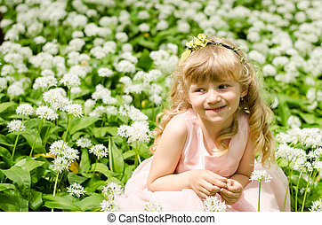 smiling child in white meadow