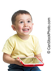 smiling child playing pc tablet
