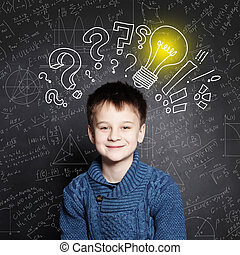 Smiling Child school boy with lightbulb on background with formulas