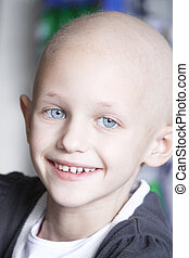 smiling child with cancer - a caucasian girl with hair loss...