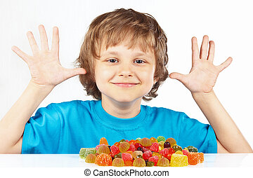 Smiling child with candies on white background