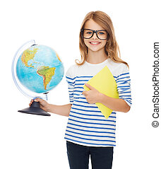 smiling child with globe, notebook and eyeglasses