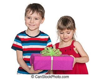 Smiling children hold a gift box