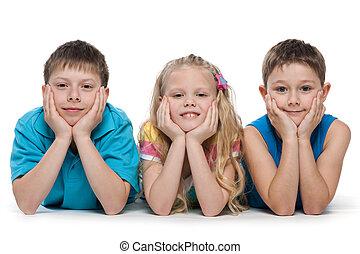 Smiling children on the white