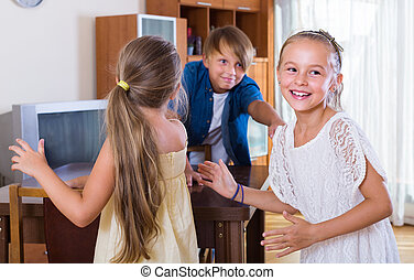 smiling children playing romp game Touch-last at home