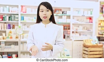 Chinese female pharmacist offers an antibacterial agent in modern pharmacy