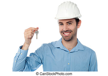 Smiling civil engineer holding key