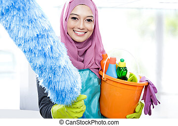 smiling cleaner young woman wearing hijab