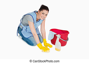 Smiling cleaning woman washing the floor