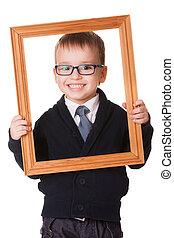 Smiling clever boy in wooden frame