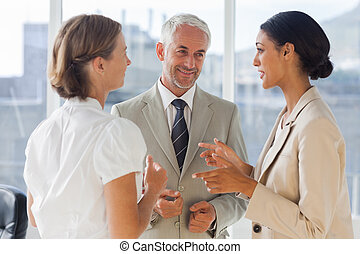 Smiling colleagues discussing together