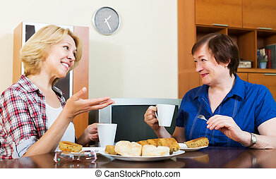smiling colleagues drinking coffe and chatting during pause for