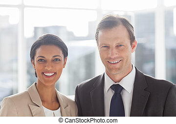 Smiling colleagues in office