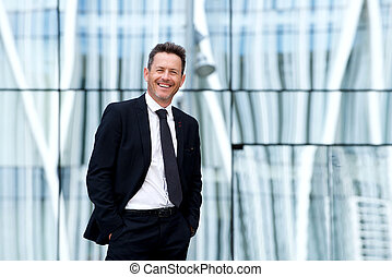 Smiling confident businessman in suit and tie