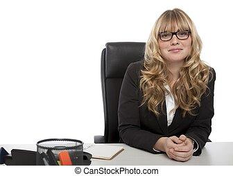 Smiling confident businesswoman in glasses
