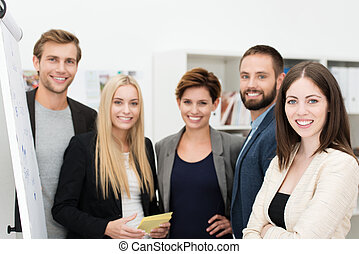 Smiling confident group of business people