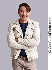 smiling confident man with hands folded. Isolated