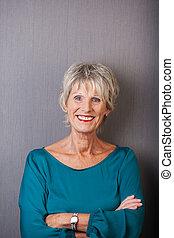 Smiling confident senior woman