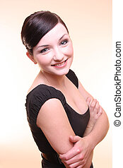 Smiling confident young woman with arms crossed