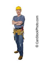 Smiling construction worker full length on white