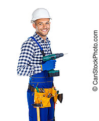 Smiling construction worker with drill and tool belt