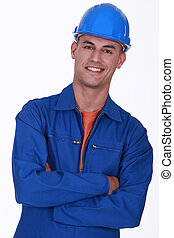 smiling construction worker with folded arms