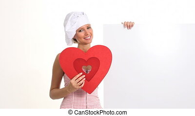 smiling cook with heart and signboa