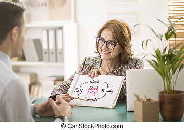 Smiling corporate life coach