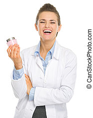Smiling cosmetologist woman with creme