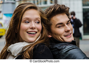 Smiling Couple Back To Back