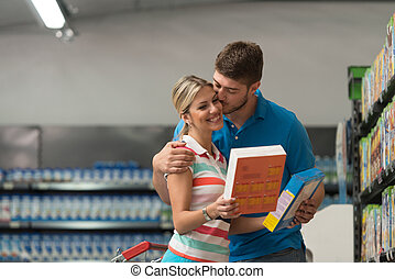 Smiling Couple Buying Flakes In Supermarket - Beautiful...
