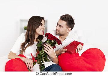 Smiling couple celebrating Valentine's day