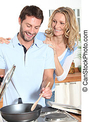 Smiling couple cooking