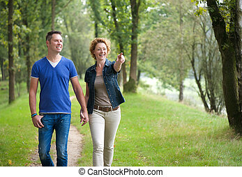 Smiling couple enjoying a walk outdoors
