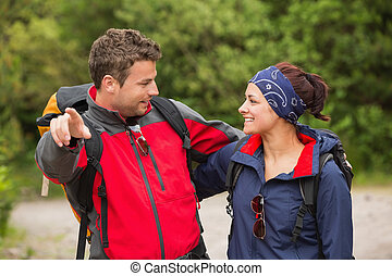 Smiling couple going on a hike