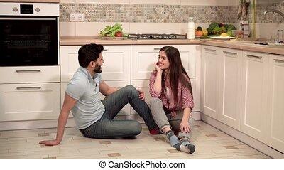 Smiling Couple Having Pleasant Conversation