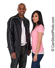 Smiling couple holding hands - African American guy with Asian girlfriend.