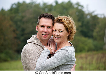 Smiling couple hugging outdoors