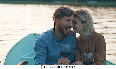 Smiling couple in a boat