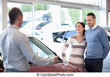 Smiling couple in a car shop