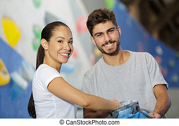 smiling couple in climbing gym