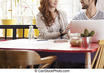 Smiling couple in hipster cofee shop