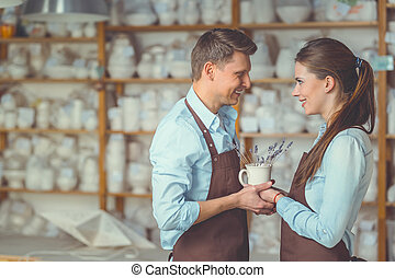 Smiling couple in pottery