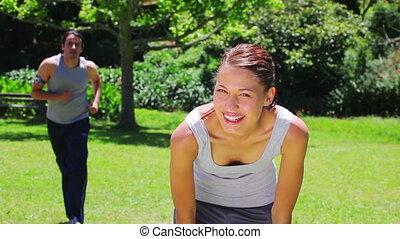Smiling couple jogging together