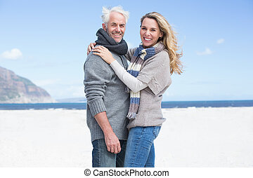 Smiling couple looking at camera on