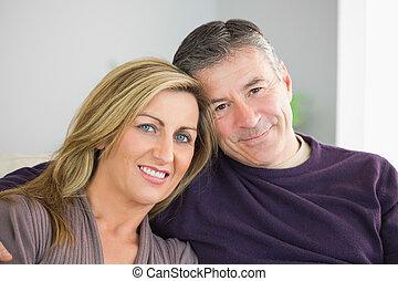 Smiling couple looking at camera