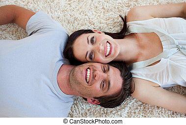 Smiling Couple lying on the floor