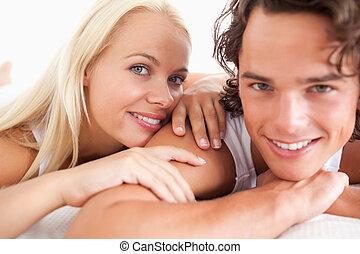 Smiling couple lying