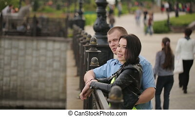 Smiling Couple Near a Pond