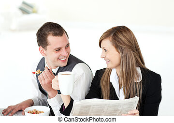 Smiling couple of business people h
